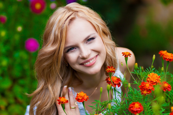 Smiling woman in flowers